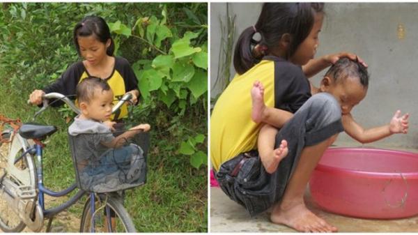 Không cầm được nước mắt khi nghe chuyện bé gáι 13 tuổι bế em 14 tháng tuổι đến trường
