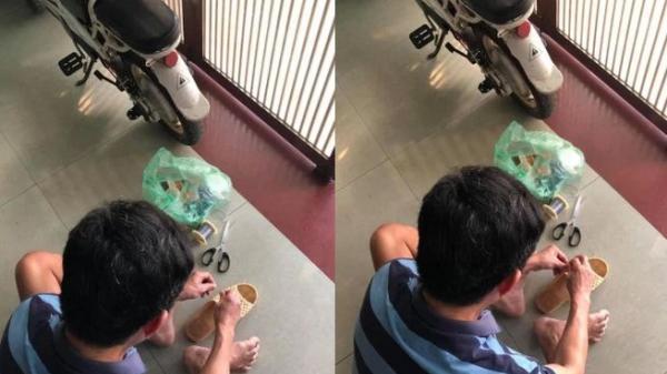 Người đàn ông ngồi buộc lại đôi dép tổ ong đã rách sau 2 năm dùng và chuyện kể của những đứa con gây xúc động