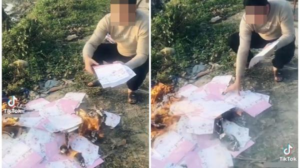 Phát hiện bạn gái có bầu với người khác, chàng trai đốt hàng trăm tấm thiệp cưới ở bãi rác